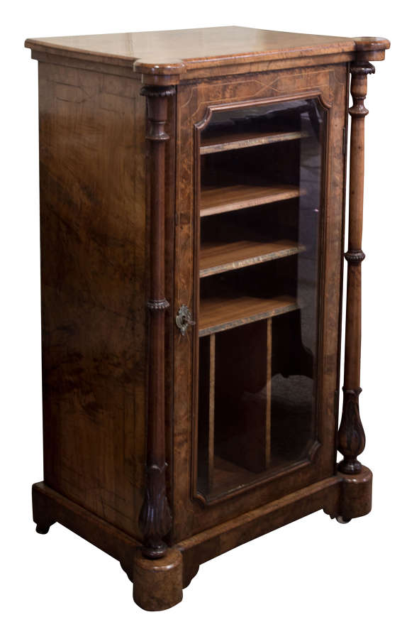 French walnut music cabinet with greek columns and set on casters