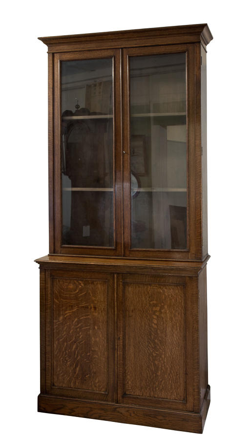 Light oak bookcase with 2 glazed and 2 panelled doors
