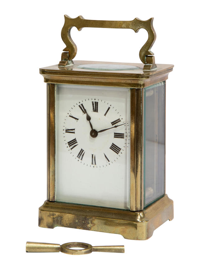 A French brass cased carriage clock timepiece with enamel dial