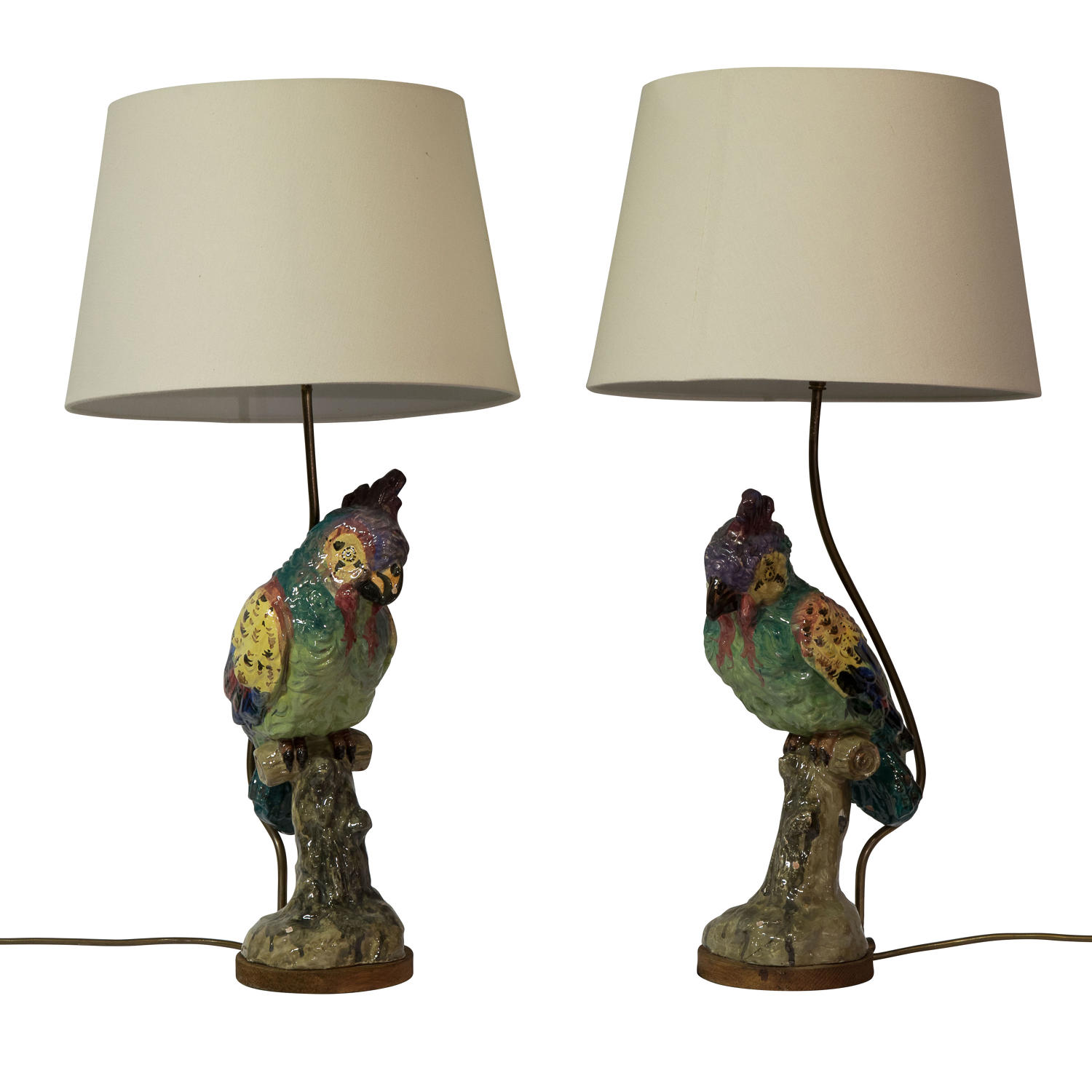 A pair of decorative parrot lamps