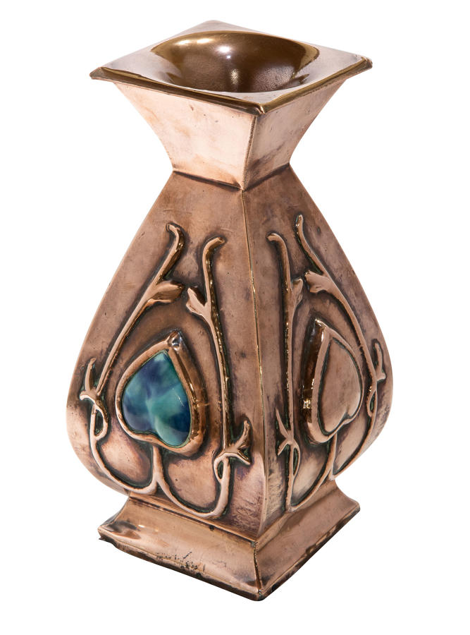 An arts and crafts copper vase with Ruskin style insets
