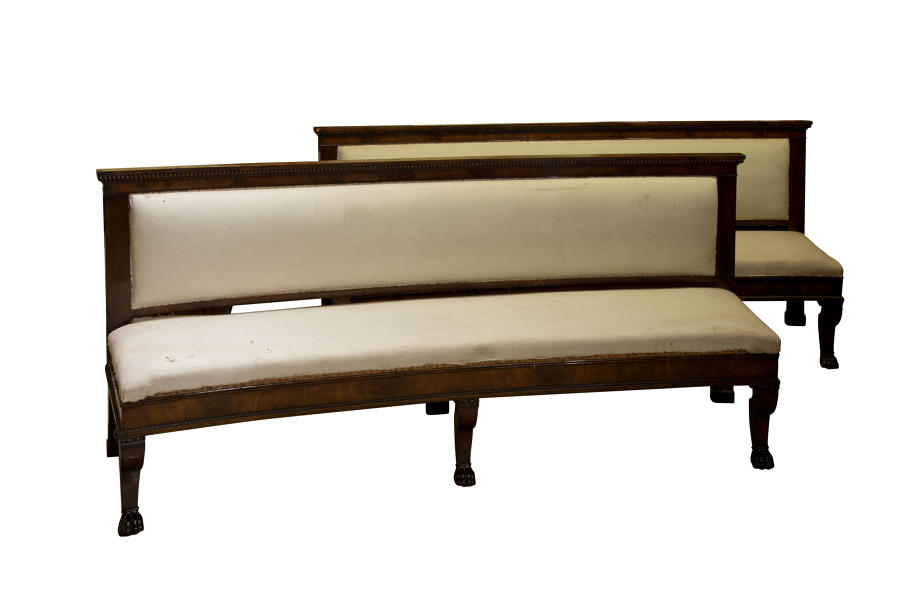 A pair of Regency carved mahogany benches