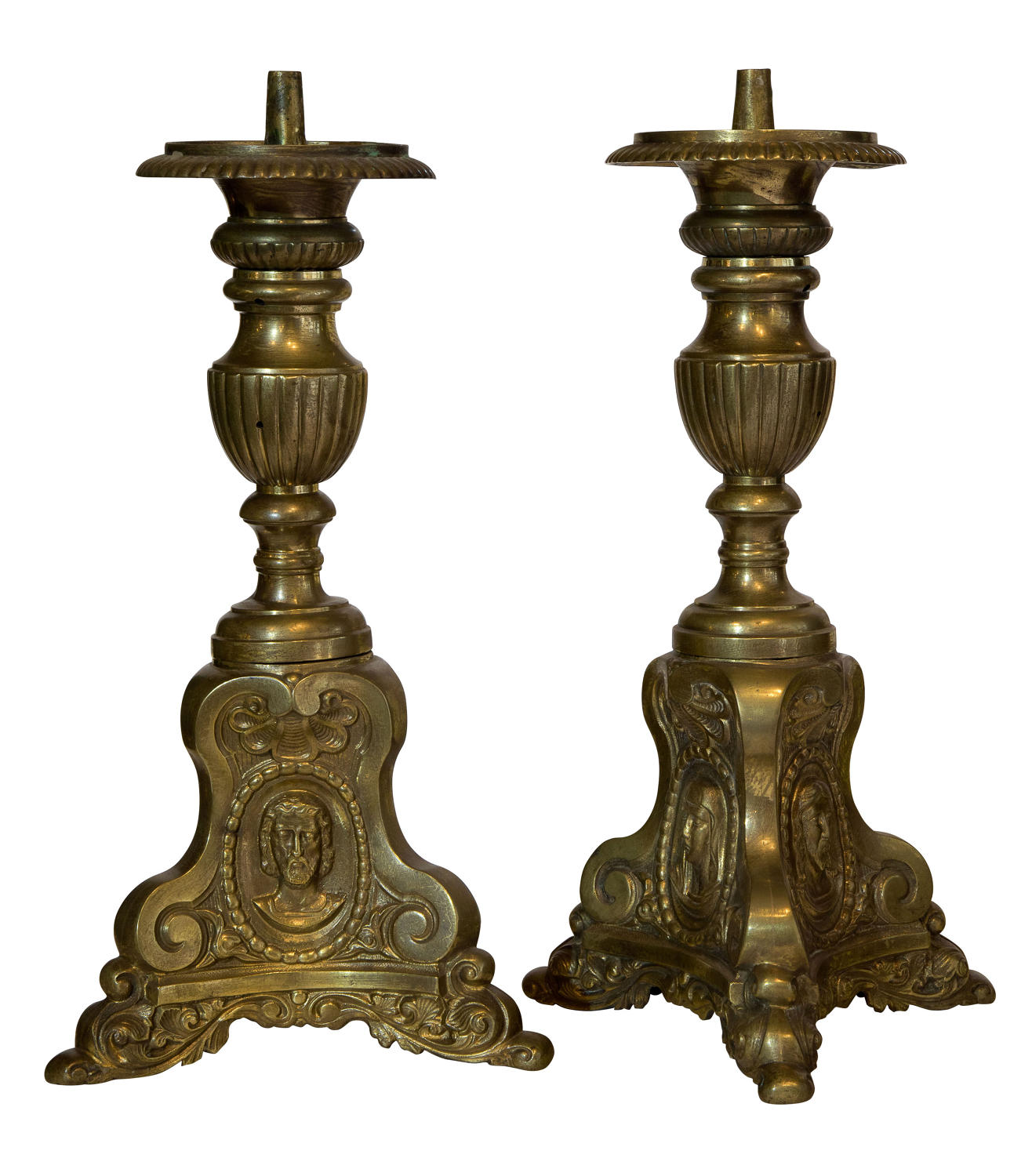 Pair of continental brass candlesticks on triform bases