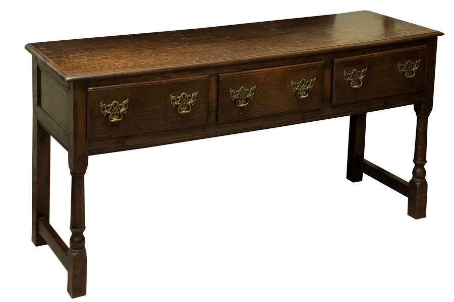 Solid oak English dresser base with three drawers c1910