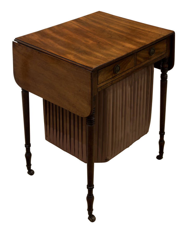 Regency period sewing/sofa table standing on fine turned legs