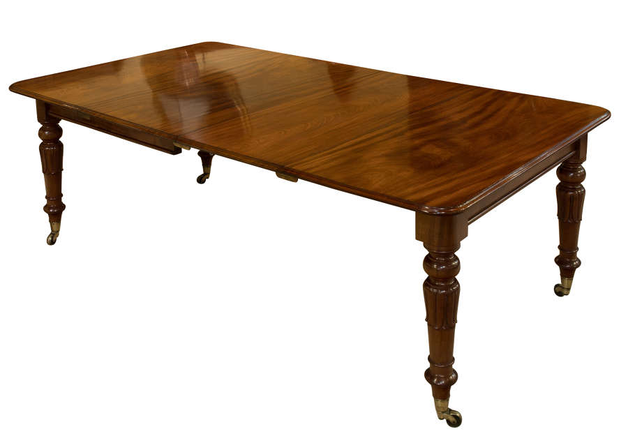 Exceptional and original two leaf mahogany dining table c1830