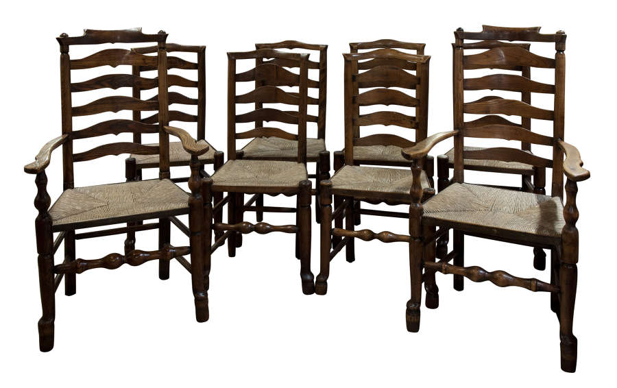 Fine set of 6+2 ash ladder back chairs of lovely colour & patina c1820