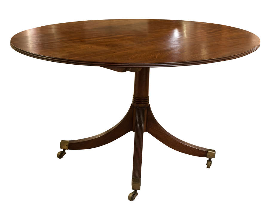 Regency mahogany oval breakfast table on turned pillar legs c1820