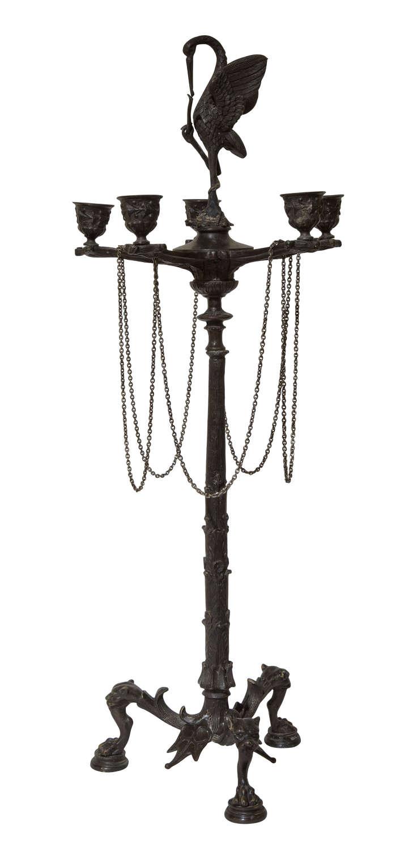 19thC bronze six light candelabra surmounted by a stork with a snake