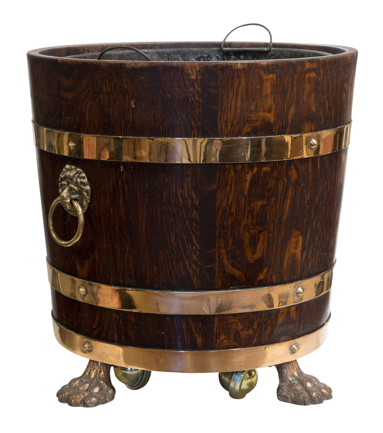 Oak and brass coopered log bin with liner standing on lion paw feet