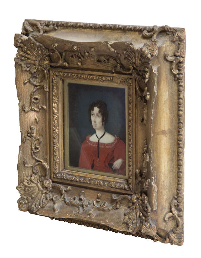 Miniature painting of a fashionable young lady in a gilt frame c1880