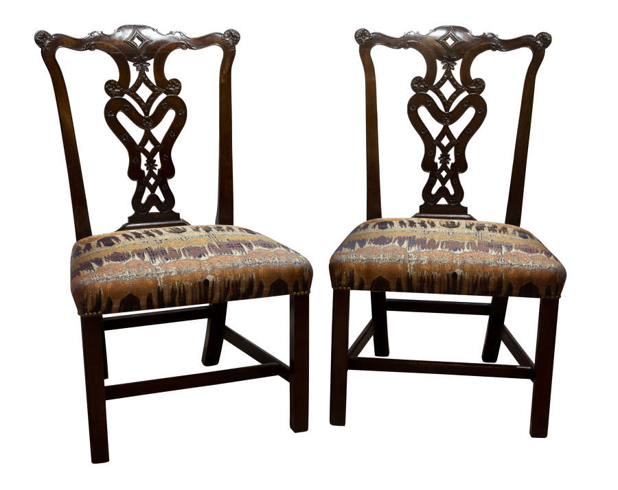 Pair of George III Chippendale period carved mahogany side chairs