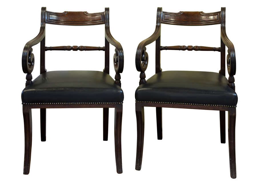Pair of regency mahogany elbow chairs on sabre front legs c1815