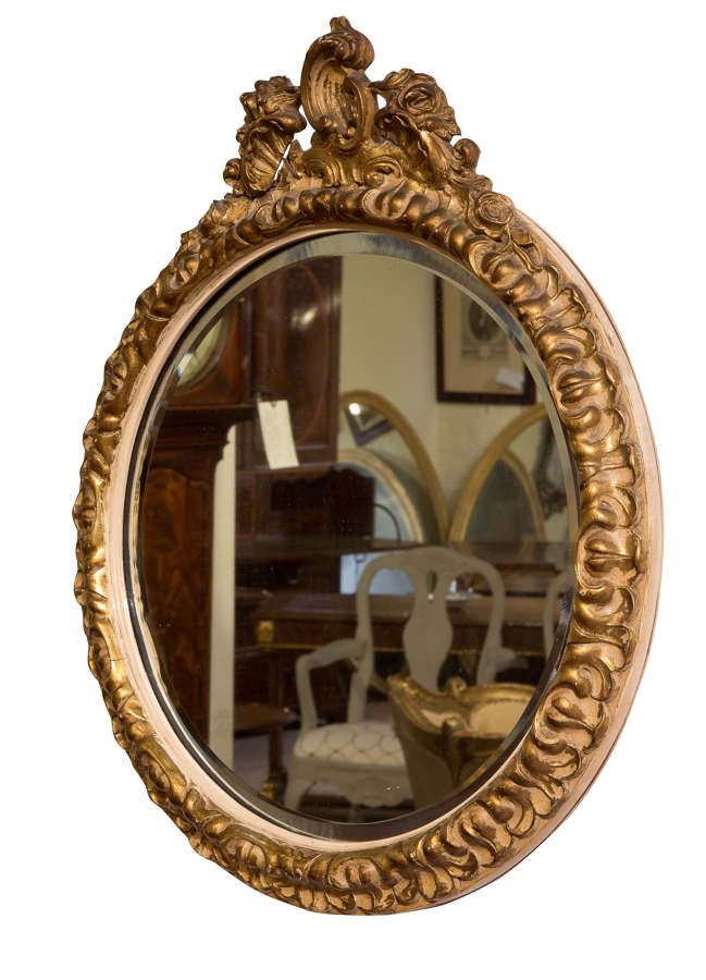 Small ornate circular bevel-plate wall mirror c1920