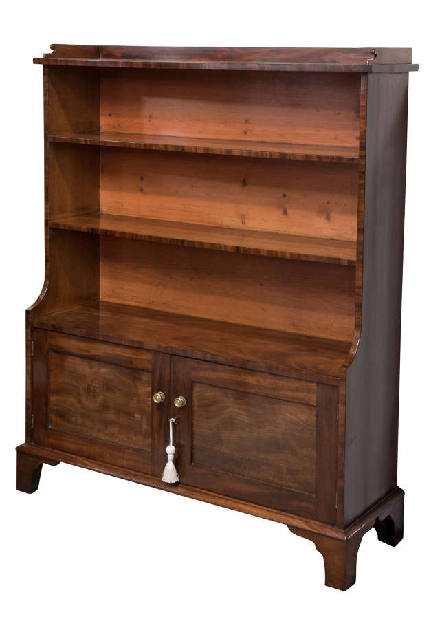 19thC mahogany 'waterfall' bookcase with a pair of panel cupboards