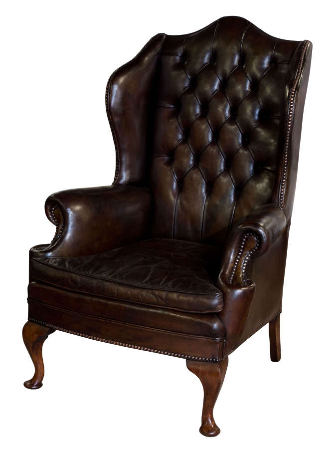 Brown leather wing chair on mahogany legs c1930
