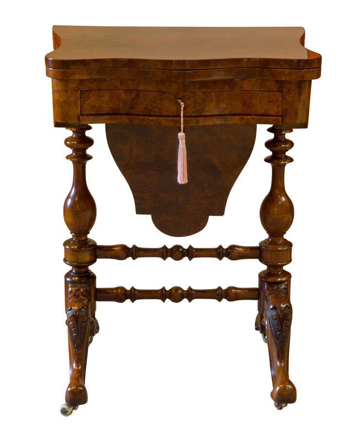 A Victorian Walnut & Burr Walnut Games and Sewing Table