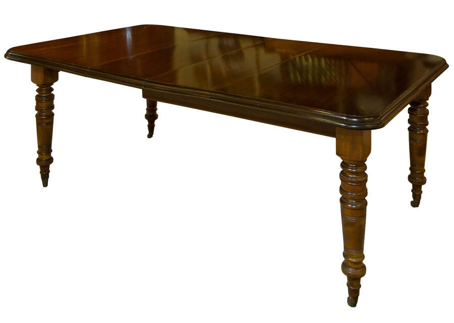 A Victorian Mahogany Two Leaf Extending Dining Table