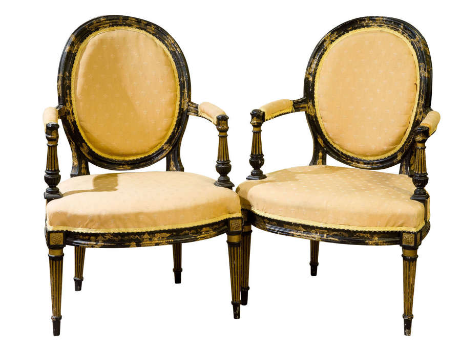 Pair of 19th black lacquered elbow chairs c1865