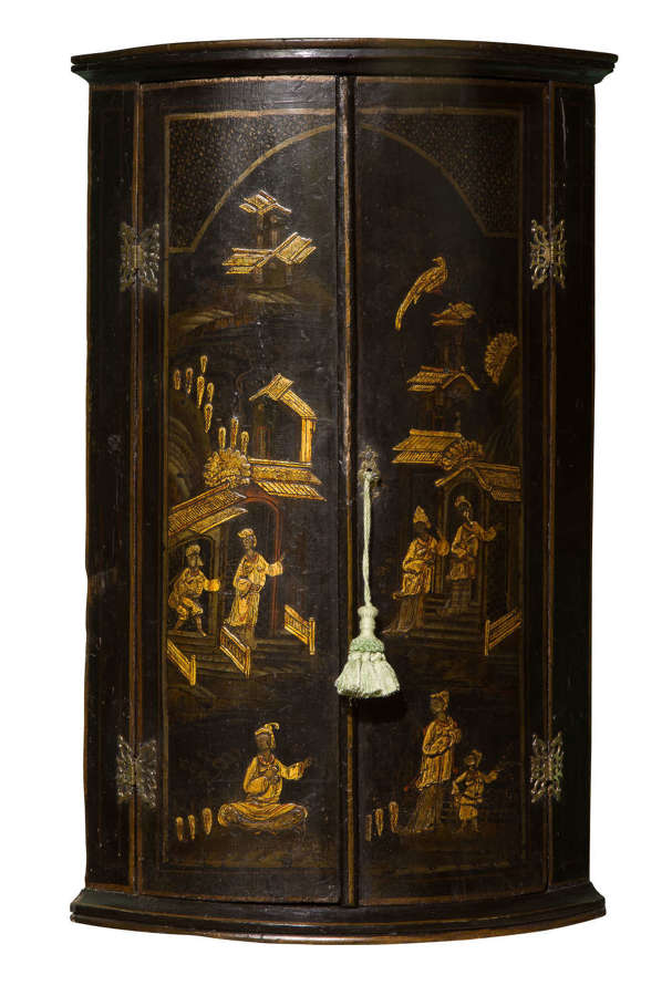18thc bowfronted lacquered corner cupboard