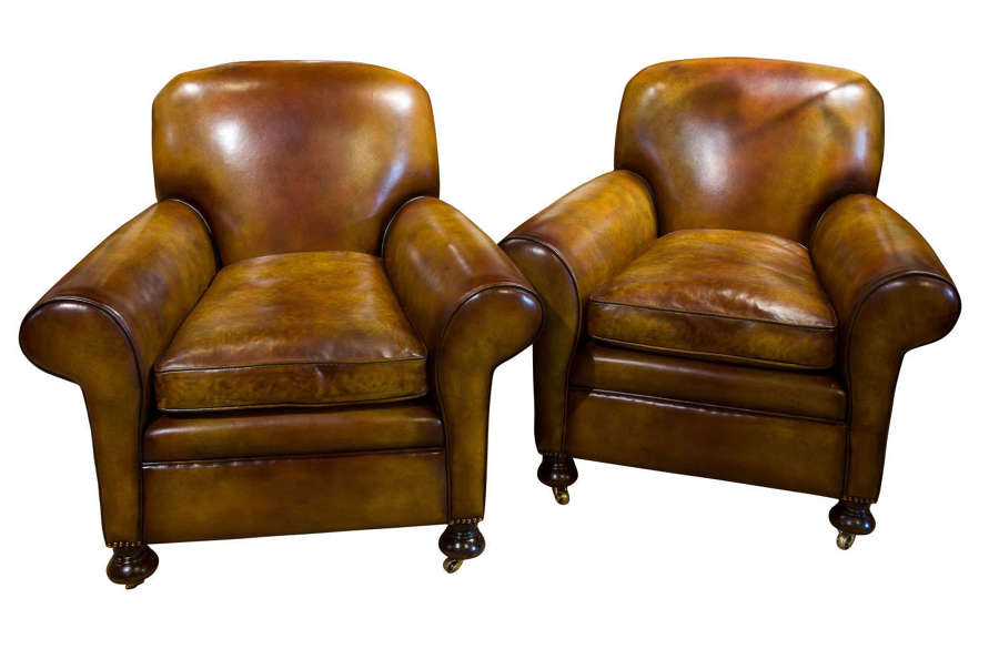 Pair of leather club chairs c1890