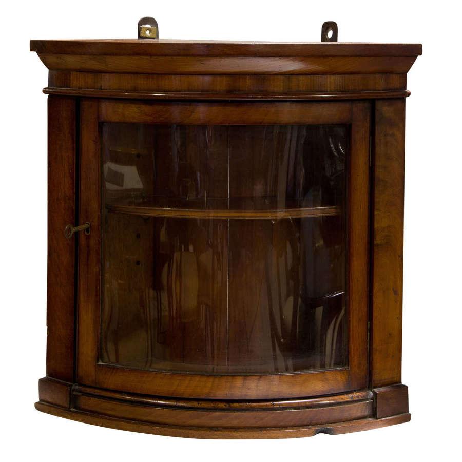 Small mahogany bowfronted corner cabinet