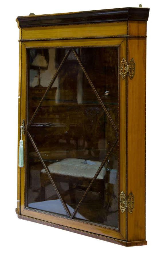 A fine quality edwardian glazed satinwood corner cabinet