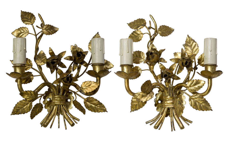 A pair of decorative wall sconces