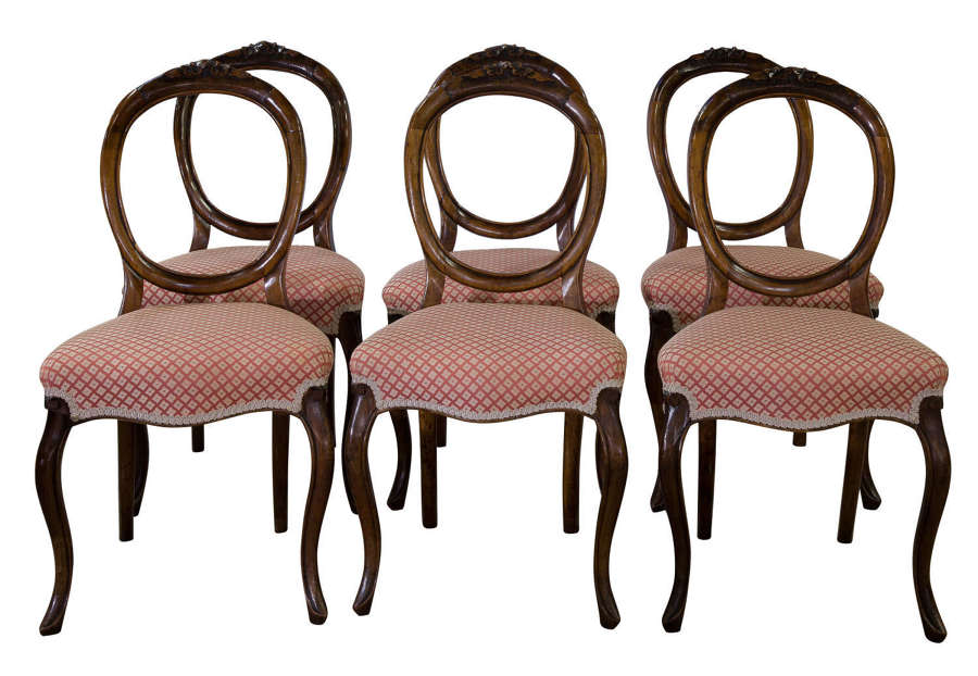 A set of 6 Victorian walnut balloon back dining chairs