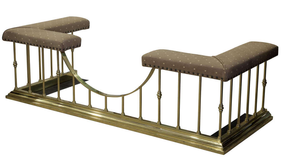 A Brass and Upholstered Club Fender